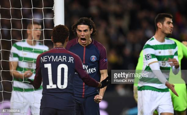 Paris SaintGermain's Uruguayan striker Edinson Cavani celebrates with teammate Brazilian striker Neymar after scoring his team's third goal during...