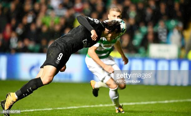 Paris SaintGermain's Uruguayan striker Edinson Cavani scores his second goal their fifth with this diving header during the UEFA Champions League...
