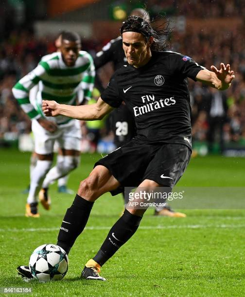 Paris SaintGermain's Uruguayan striker Edinson Cavani scores their third goal from the penalty spot during the UEFA Champions League Group B football...