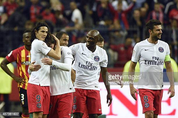 Paris SaintGermain's Uruguyan forward Edinson Cavani congratulates Paris SaintGermain's Brazilian defender Maxwell after he scored a goal during the...