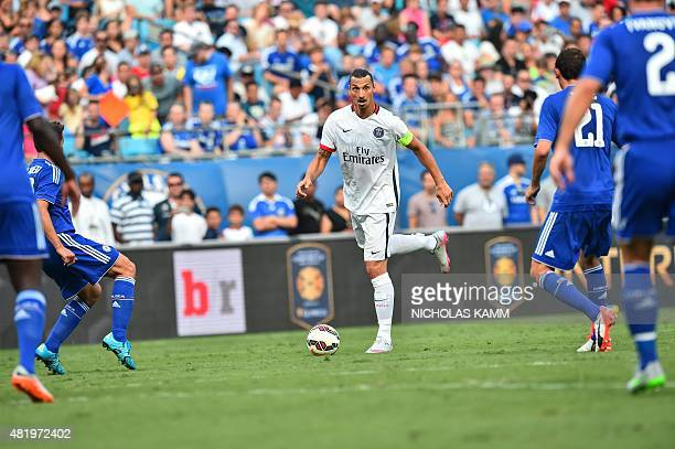 Paris SaintGermain's Zlatan Ibrahimovic looks to pass the ball against Chelsea during an International Champions Cup football match in Charlotte...