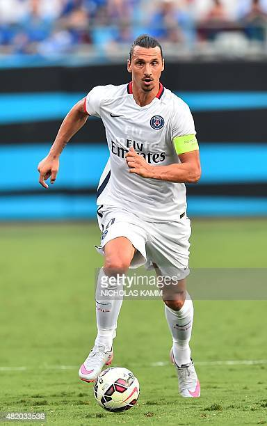 Paris SaintGermain's Zlatan Ibrahimovic runs with the ball during an International Champions Cup football match against Chelsea in Charlotte North...