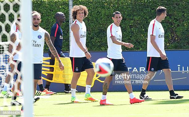 Paris SantGermain's Angel Di Maria David Luiz and Layvin Kurzawa watch the bouncing ball on arrival for a training session at Loyola Marymount...