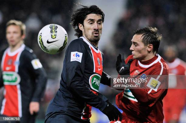 Paris' Serbian defender Milan Bisevac vies with Dijon's French midfielder Eric Bautheac during the French Cup football match Dijon vs...