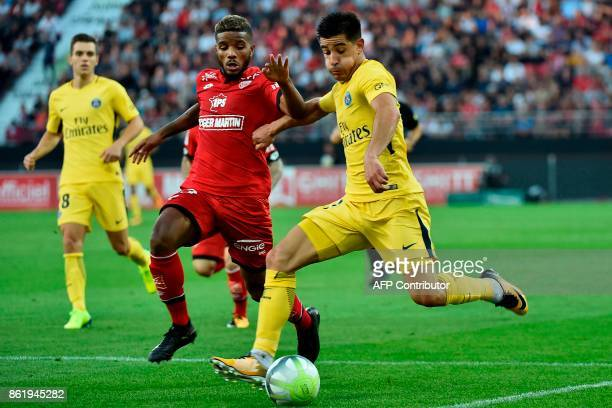 Paris' Spanish defender Yuri Berchiche vies with Dijon's French defender Valentin Rosier during the French L1 football match between Dijon and Paris...