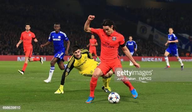 Paris St Germain's Edison Cavani attempts to round Chelsea goalkeeper Thibaut Courtois but his shot hits the post
