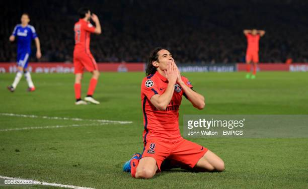 Paris St Germain's Edison Cavani dejected after he attempts to round Chelsea goalkeeper Thibaut Courtois but his shot hits the post