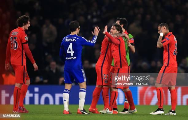 Paris St Germain's Maxwell high fives Chelsea's Cesc Fabregas after the match