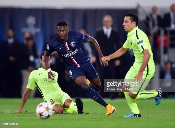 Paris StGermain's JeanChristophe Bahebeck and Barcelona's Sergio Busquets battle for the ball