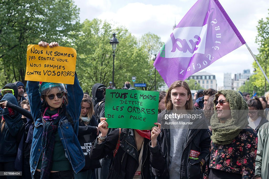 Paris students demonstrate against the 'El Khomri' law project at Les Invalides on May 3, 2016 in Paris, France. After weeks of contestation and several demonstrations, French Minister of Labor, Employment and Social dialogue, Myriam El Khomri presented her text for the 'El Khomeri' labor law project' in front of the National Assembly.