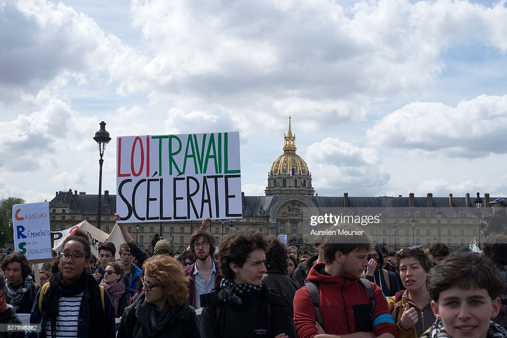 Paris students demonstrate holding signs against the 'El Khomri' law project at Les Invalides on May 3, 2016 in Paris, France. After weeks of contestation and several demonstrations, French Minister of Labor, Employment and Social dialogue, Myriam El Khomri presented her text for the 'El Khomeri' labor law project' in front of the National Assembly.