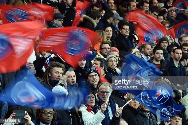 Paris' supporters cheer their team during the French Cup football match Paris SaintGermain vs Nantes at the ParcdesPrinces stadium in Paris on...