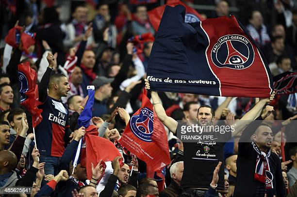 Paris' supporters cheer their team prior to the French League Cup final football match between Paris SaintGermain and Lyon on April 19 2014 at the...