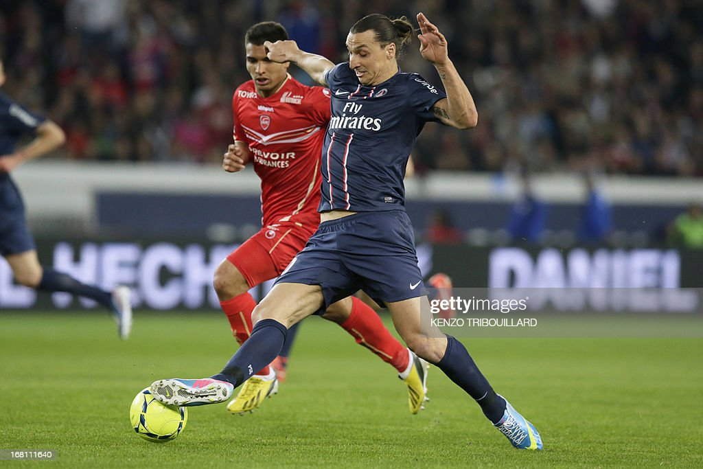 Paris' Swedish forward Zlatan Ibrahimovic (R) vies for the ball with Valenciennes French defender Lindsay Rose during the French L1 football match Paris Saint-Germain vs Valenciennes at the Parc des Princes in Paris on May 5, 2013. AFP PHOTO / KENZO TRIBOUILLARD