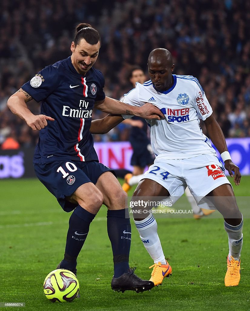 Paris' Swedish forward Zlatan Ibrahimovic vies with Marseille's French defender Rod Fanni during the French L1 football match between Marseille and...
