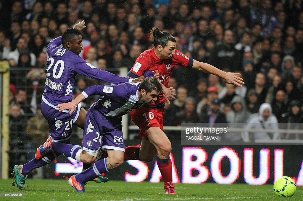 Paris' Swedish forward Zlatan Ibrahimovic (R) vies with Toulouse's Portuguese midfielder Yannick Djalo (L) and Serbian defender Pavle Ninkov (c) during the French L1 football match Toulouse (TFC) vs Paris Saint-Germain (PSG) on February 1, 2013 at the Stade Municipal in Toulouse.