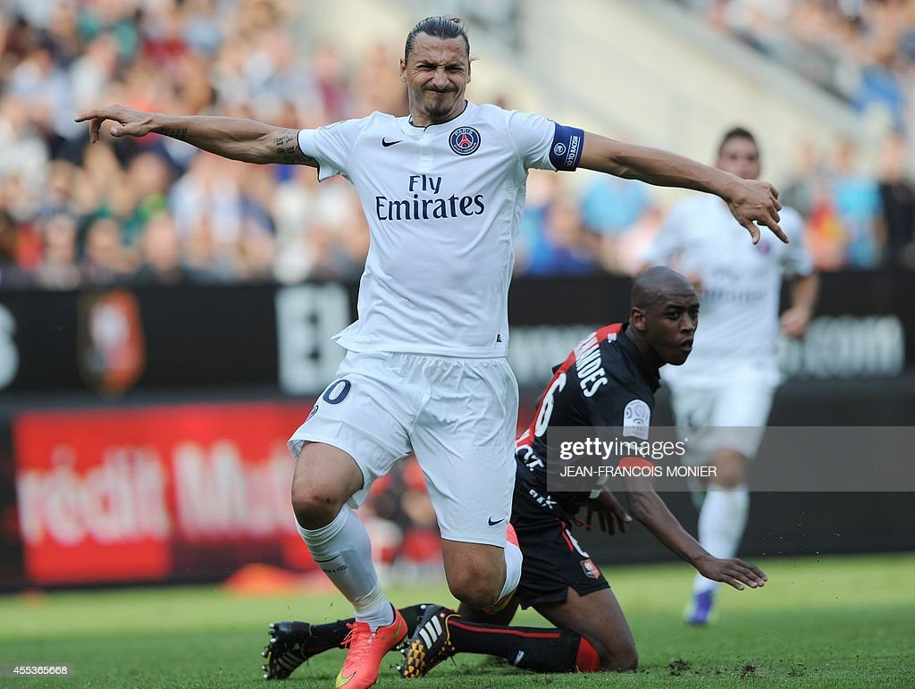 Paris' Swedish midfielder Zlatan Ibrahimovic falls after being tackled by Rennes' Swiss midfielder Gelson Fernandes Tavares during the French L1...