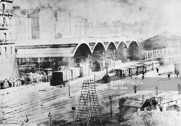 Paris The gare SaintLazare in 1850 On the right a train pulled by a 'Buddicon' engine from 1843 On the left freight cars located on the former...