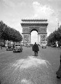 Paris View of the Arc de Triomphe from the ChampsEysees avenue 1938