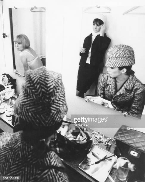 Paris women in a dressing room probaly models getting ready for the fashion show