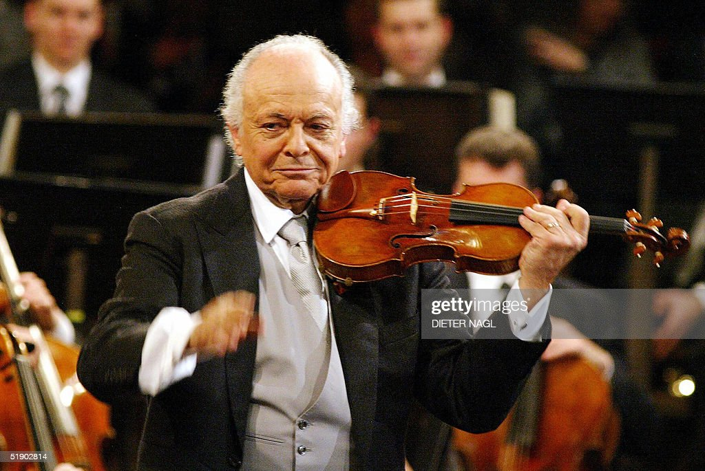 Paris-born US conductor <a gi-track='captionPersonalityLinkClicked' href=/galleries/search?phrase=Lorin+Maazel&family=editorial&specificpeople=935587 ng-click='$event.stopPropagation()'>Lorin Maazel</a> plays the violin during the rehearsal of the Vienna Philharmonic orchestra at the 'Goldener Musikvereinsaal' in Vienna for the upcoming New Year concert, 30 December 2004.