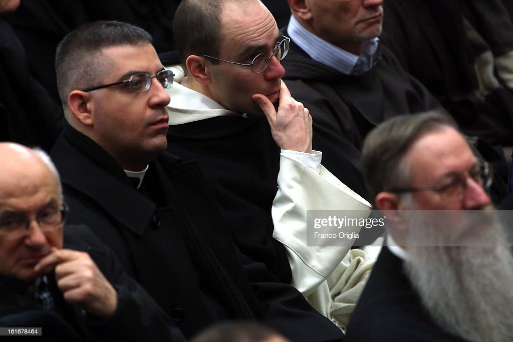 Parish priests of Rome's diocese attend a meeting with Pope Benedict XVI at the Paul VI Hall on February 14, 2013 in Vatican City, Vatican. The Pontiff will hold his last weekly public audience on February 27 at St Peter's Square after announcing his resignation earlier this week. (Photo by Franco Origlia/Getty Images).