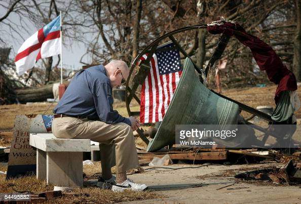 Parishioner Junius Cotten sits near the remnants of the bell tower at the conclusion of services at the Episcopal Church of the Redeemer which was...