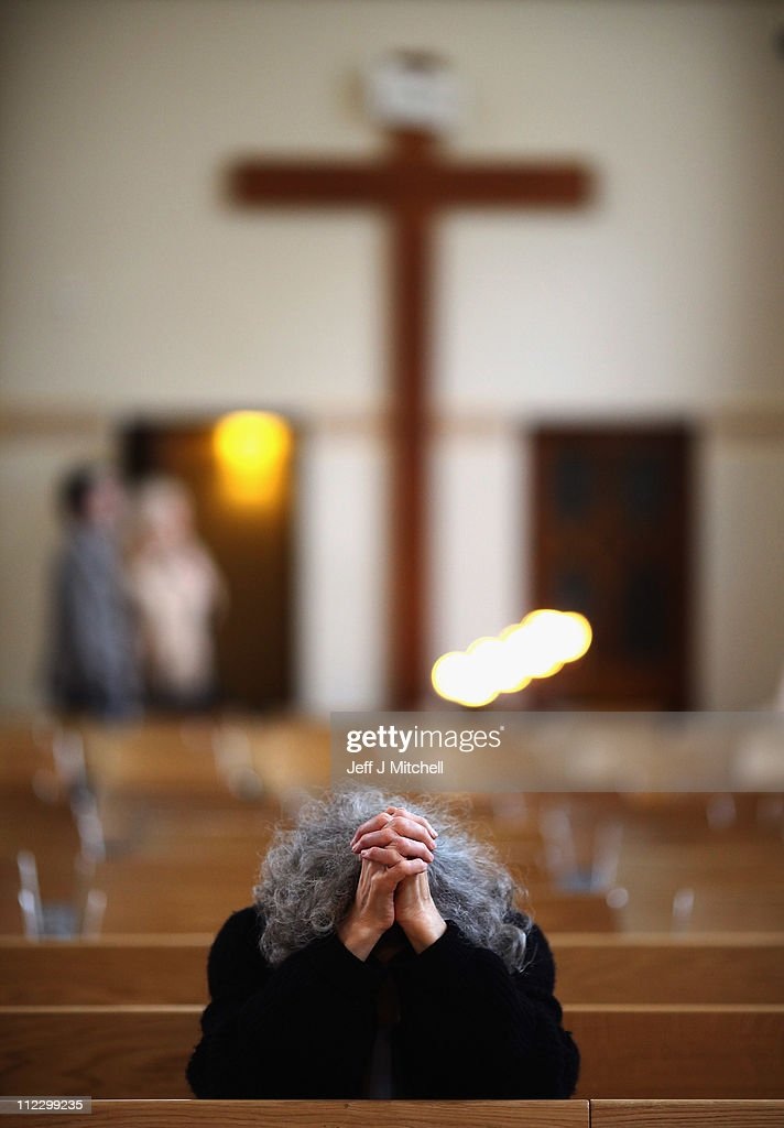 A parishioner prays during mass at the newly refurbished Saint Andrew's Metropolitan Cathedral on April 18, 2011 in Glasgow, Scotland. The iconic Catholic building has reopened to the public after 4.5 million GBP of restoration work over two years, providing a new altar, font, flooring, seating, lighting and artworks including a painting of St John Ogilvie by renowned Scottish artist Peter Howson.