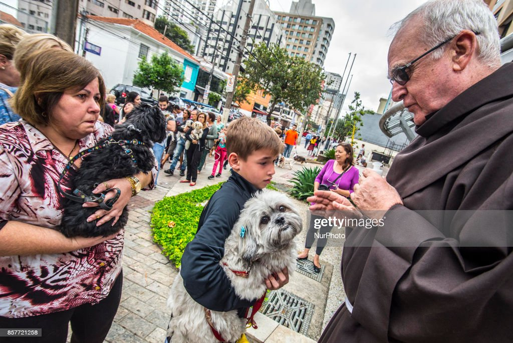 Parishioners accompanied by their pets attend a mass on the occasion of St. Francis of Assisi Day, in Sao Paulo, Brazil, 04 October 2017. St. Francis of Assisi is known in the catholic religion as the animals' protector.