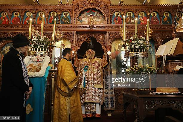 Parishioners and clergy of the Greek Orthodox Church of St Michael the Archangel attend a service for Feast of the Epiphany on January 08 2017 in...
