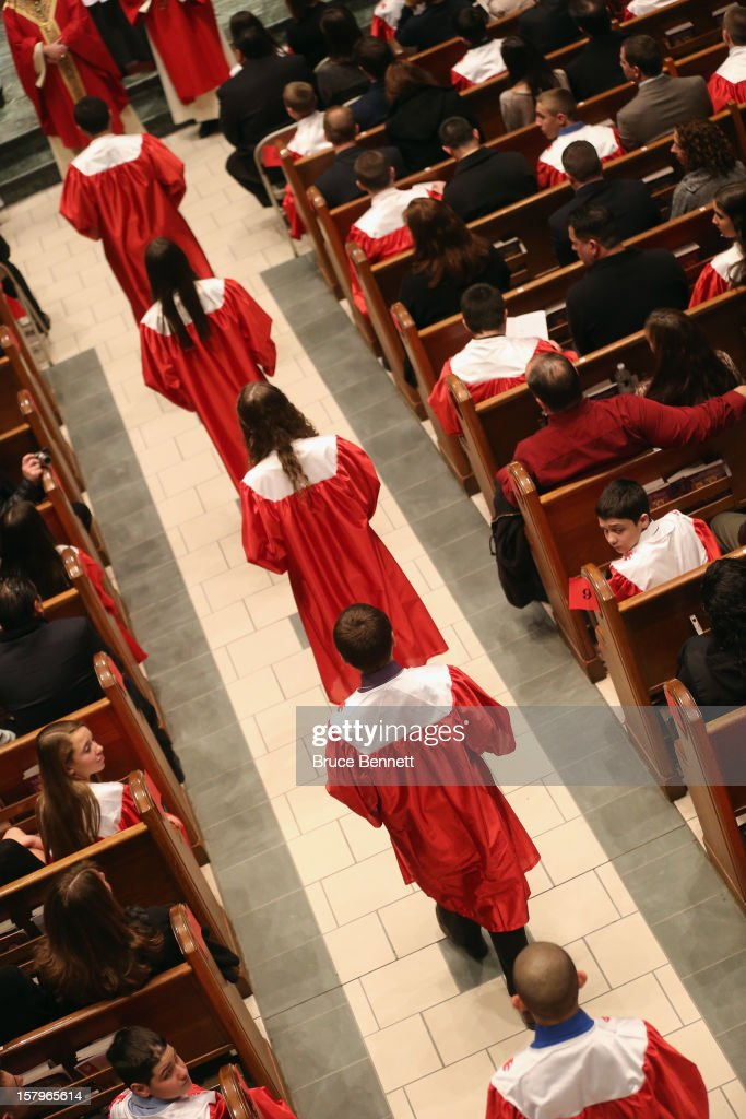 Parishioners attend The Sacrament of Confirmation ceremony at The Church of St. Martin of Tours on December 7, 2012 in Bethpage, New York.