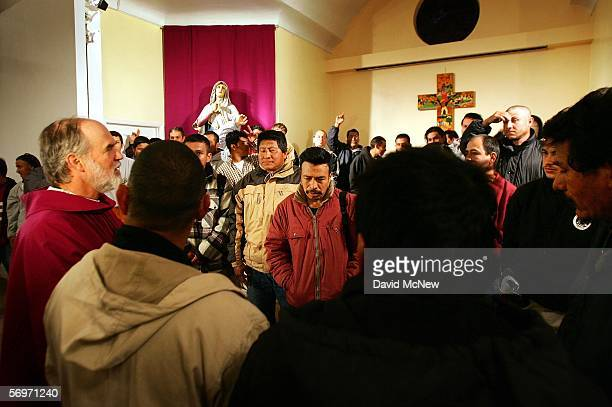 Parishioners participate in an Ash Wednesday service for undocumented immigrants led by Father Michael Kennedy at the Dolores Mission Church on March...