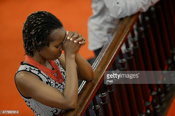 Parishioners pray as they attend the first church service four days after a mass shooting that claimed the lives of nine people at the historic...