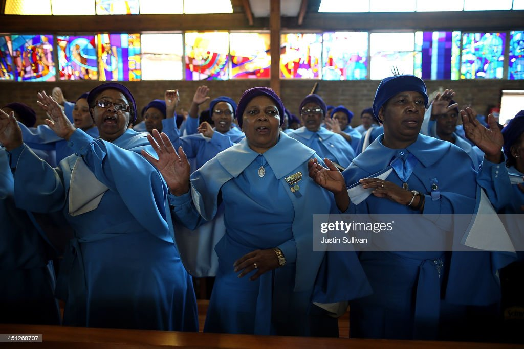 Parishioners sing during church services at Regina Mundo Catholic Church as South Africans observe a national day of prayer for Nelson Mandela on December 8, 2013 in Soweto, South Africa. Mandela, also known as Madiba, passed away on the evening of December 5th, 2013 at his home in Houghton at the age of 95. Mandela became South Africa's first black president in 1994 after spending 27 years in jail for his activism against apartheid in a racially-divided South Africa.