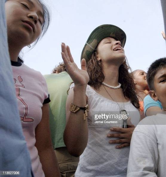 Parishioners sing praise hymns at the Billy Graham Farewell Crusade at Flushing Meadows Park in New York City New York on Sunday June 26 2005