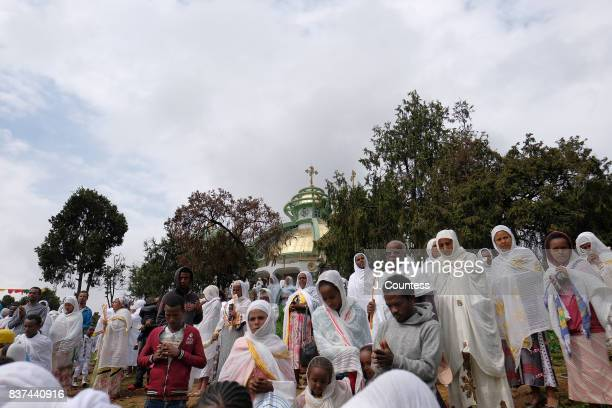 Parishoners bow and pray as priests carrying the Tabot a representation of the Ark of the Covenant lead followers of the Ethiopian Orthodox Tewehedo...
