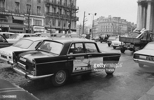 Parisian taxis equiped with advertissment panels
