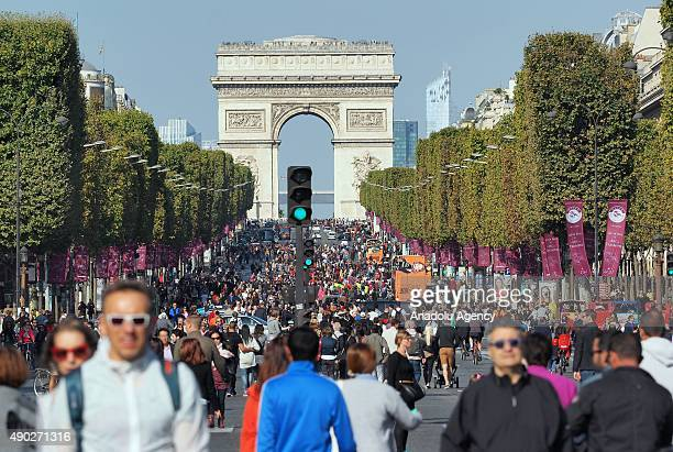 Parisians gather along the Avenue des ChampsElysees during the 'Day Without Cars' in Paris on September 27 2015 Many of Paris' tourist hotspots were...