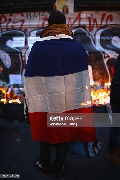 Parisians light candles and lay tributes on the monument at Place de la Republique the day after deadly terrorist attacks on November 14 2015 in...