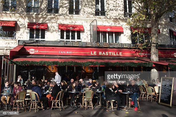 Parisians sitting on the terraces of bars as usual on Sunday in Place de la Bastille on November 15 2015 in Paris France At least 120 people have...