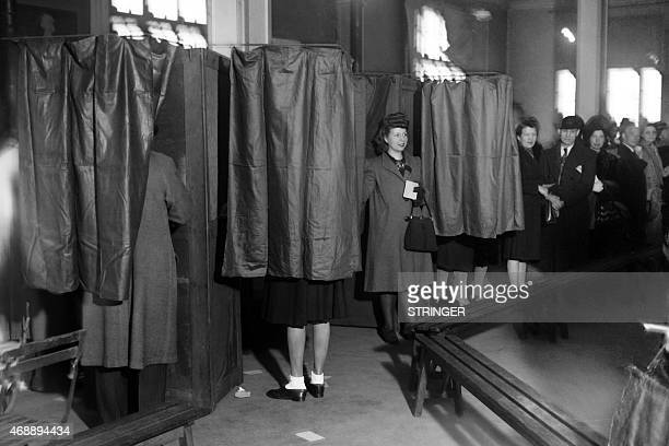 Parisians voters are pictured in polling booth on mai 13 during municipal elections in Paris The 21 April 1944 ordinance of the French Committee of...