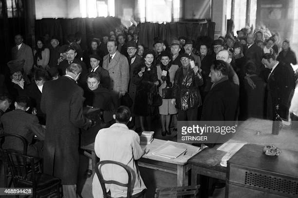 Parisians voters put their ballot on mai 13 during municipal elections in Paris The 21 April 1944 ordinance of the French Committee of National...
