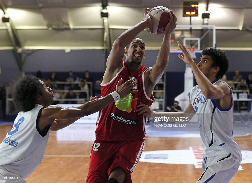 Paris-Levallois' John Cox (L) and Louis Labeyrie (R) fight for the ball with Strasbourg IG's Alexis Ajinca (C) on February, 16, 2013 during a leaders cup LNB 2013 tournament basketball semi-final match in Marne-la-Vallee, west of Paris. GUILLOT