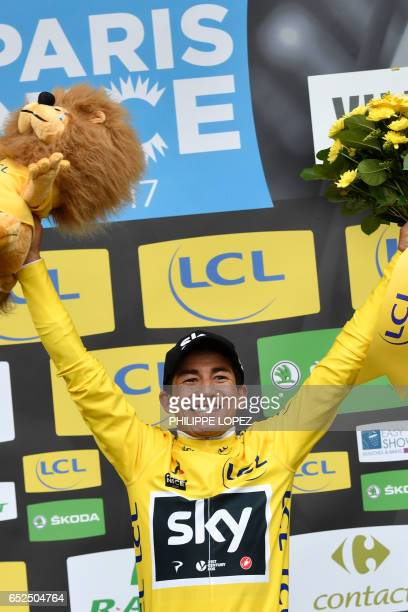 ParisNice 2017 winner Colombia's Sergio Henao celebrates his overall leader yellow jersey on the podium at the end of the 1155 km eighth and last...