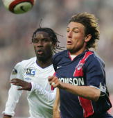 Paris's defender Gabriel Heinze and Lyon's forward Peguy Luyindula fight for the ball during the French first league football match15 May 2004 at the...
