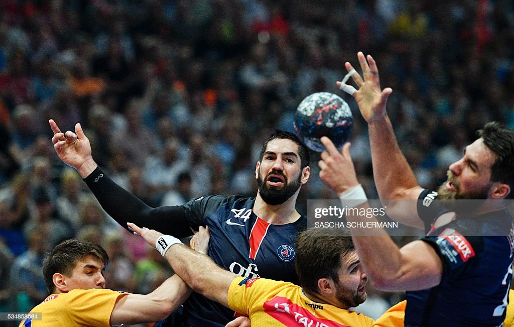 Paris's Nikola Karabatic (2L) vies for the ball during the Handball EHF Champions League final Four semi final match between KS Vive Tauron Kielce and Paris St-Germain in Cologne, western Germany, on May 28, 2016. / AFP / SASCHA