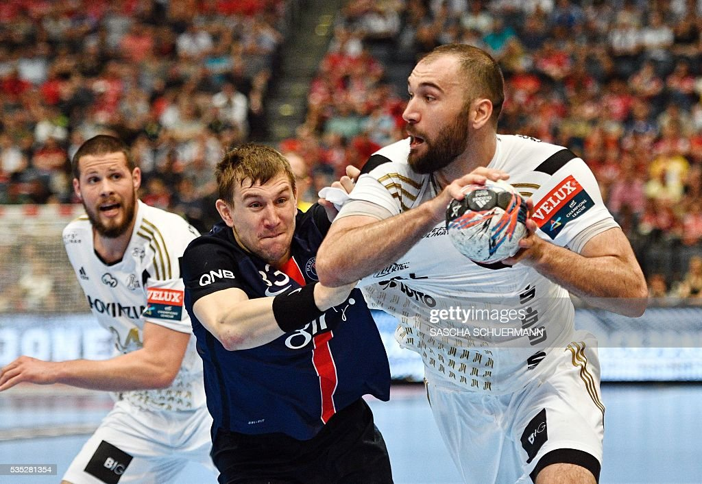 Paris's Sergiy Onufryienko (C) and Kiel's Joan Canellas (R) vie for the ball during the Handball EHF Champions League final Four semifinal match between Paris St-Germain and THW Kiel in Cologne, western Germany, on May 29, 2016. / AFP / SASCHA