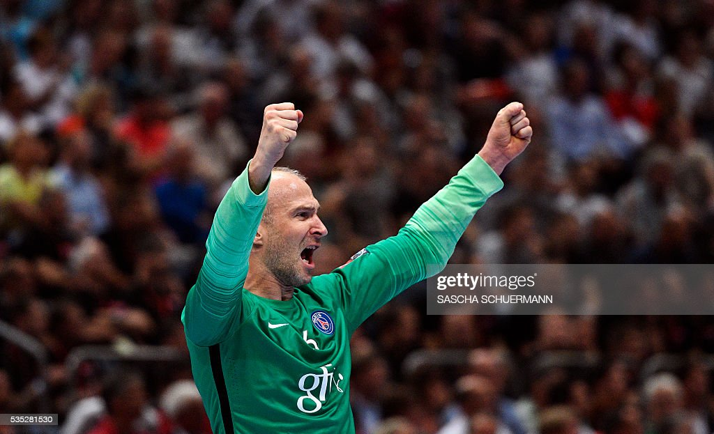 Paris's Thierry Omeyer celebrates during the Handball EHF Champions League final Four semifinal match between Paris St-Germain and THW Kiel in Cologne, western Germany, on May 29, 2016. / AFP / SASCHA