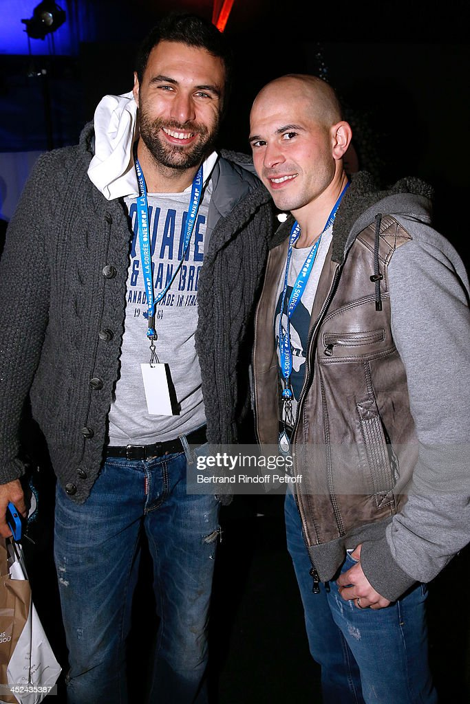 Paris-Saint-Germain Football Players Salvatore Sirigu (L) and Christophe Jallet (R) attend the 'One Drop' Gala, held at Cirque du Soleil on November 28, 2013 in Paris, France.