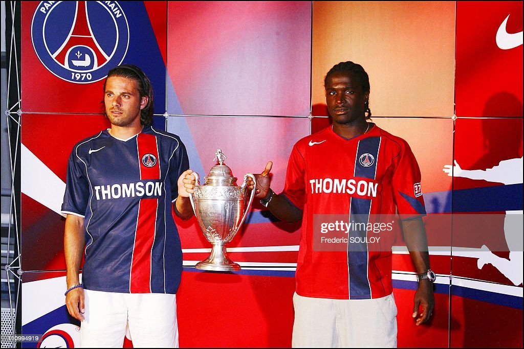 Paris-Saint-Germain Presents New Shirts At 'The 70' - Fabrice Fiorese and <a gi-track='captionPersonalityLinkClicked' href=/galleries/search?phrase=Bernard+Mendy&family=editorial&specificpeople=661868 ng-click='$event.stopPropagation()'>Bernard Mendy</a> at restaurant of the Parc des Princes stadium In Paris, France On June 29, 2004